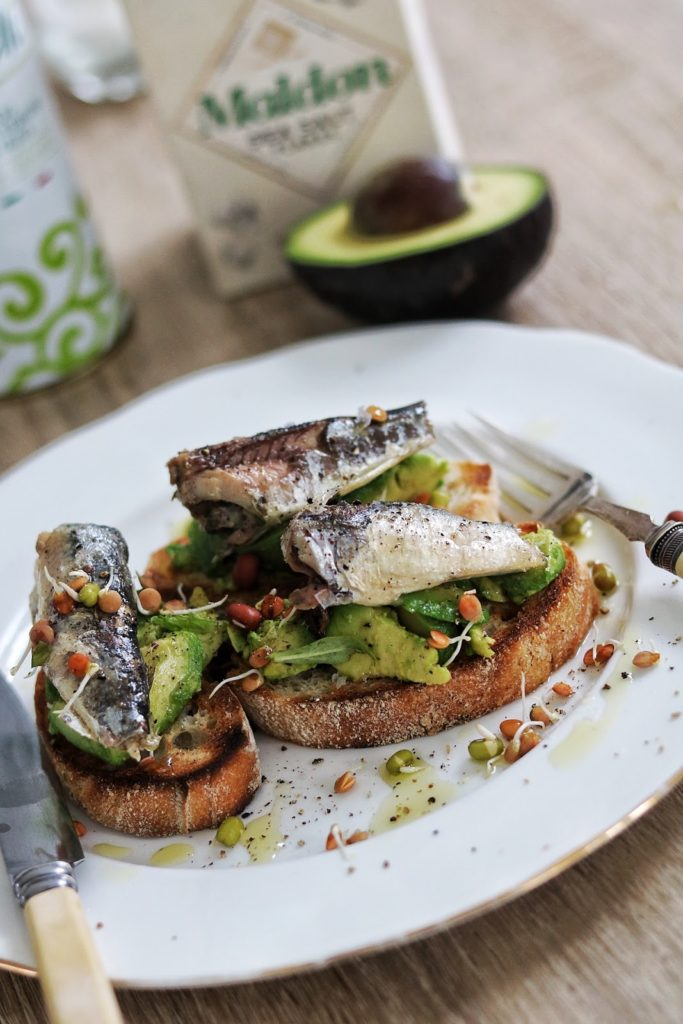 Toasted sourdough with sardines and smashed avocado
