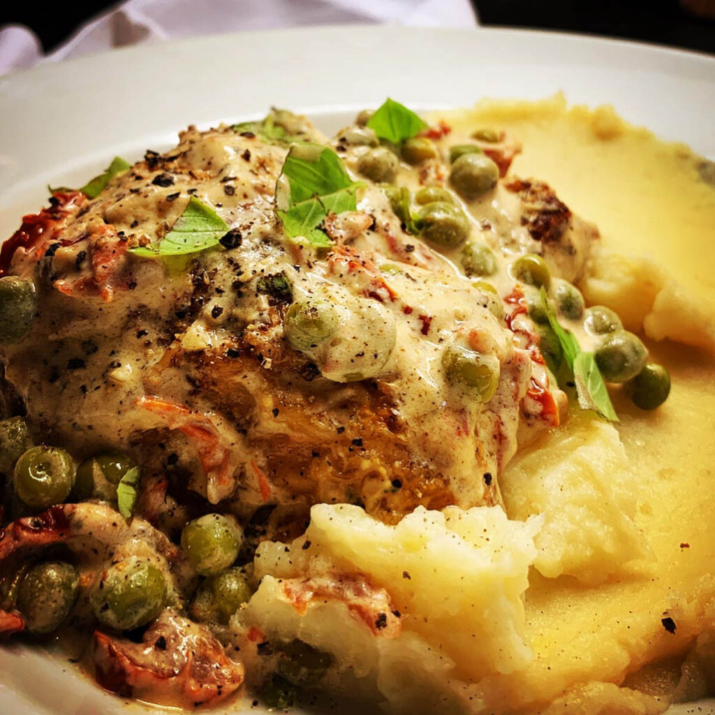 Creamy Roast Chicken with Sun-Dried Tomatoes and Peas recipe